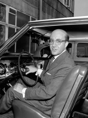 "British actor Peter Sellers shows his new 1963 American Buick during a break in filming at Shepperton Studios in Middlesex, near London, England, March 3, 1963.  Sellers is wearing a bald piece for his character in the movie ""Dr. Strangelove:  Or How I Learned to Stop Worrying and Love the Bomb."""