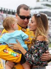 Kyle Busch stands with his wife Samantha and son Brexton