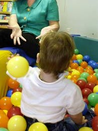 Linda Molica, in this 2002 photo, plays with one of the 2-year-old residents of The Haven.
