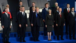 President Trump, center, flanked by British Prime Minister