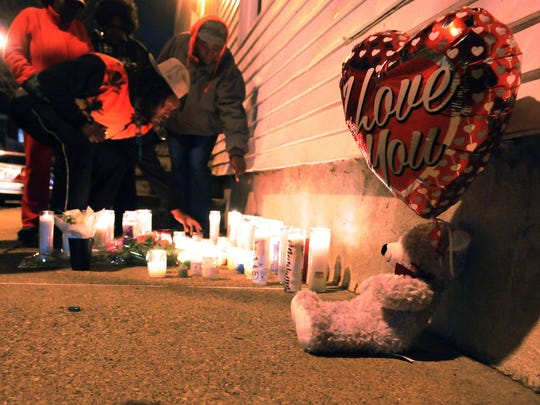 Friends gather on New Street in Montclair on Friday to light candles and remember Sarah Butler.