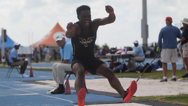 Lincoln senior Trejan Huggins leaps in the long jump. It's Huggins' first year participating in track and field, but he won a bronze medal in long jump and is a state-qualifying sprinter.