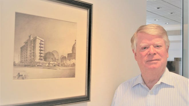 Paul Hansen stands near 1945 rendering that his father Oscar Hansen drew of a proposed Bay Street hotel.