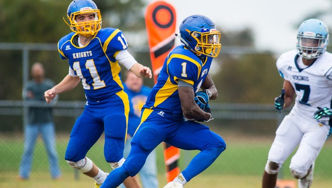 Sussex Central running back Kiante Sturgis (1) breaks off a touchdown run against Cape Henlopen on Saturday afternoon at Sussex Central.