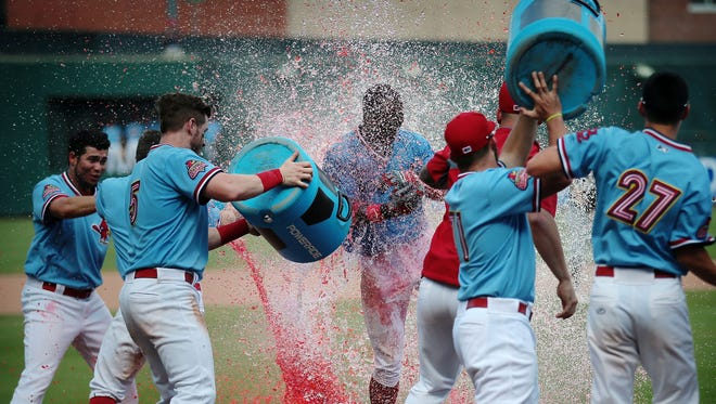 Redbirds outfielder Adolis Garcia (center) celebrates with teammates after a walk-off 2-run homer in the bottom of the 11th inning delivered Memphis a 2-0 win over El Paso in Game 2 of the Pacific Coast League championship series.