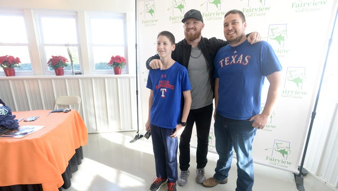 Jim Morrissey and his son, James, 13, pose for a picture with Cedar Crest grad and Houston Astros outfielder Derek Fisher on Saturday morning at Fairview Golf Course.