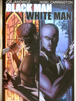 Joe Janowicz, left, and Nigel Carrington developed a comic book based in Rochester.