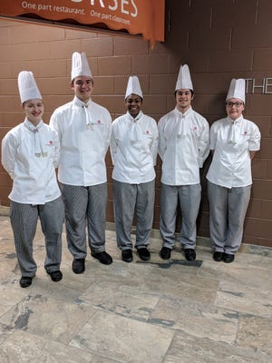 From left, Rose Erickson, Ken Pankau, Nia Tomlinson, Josh Hoffman and Jami-Lynn Rice competed on behalf of Baker College's Culinary Institute of Michigan at the ACF Central Region Student Team Championship in Madison, Wisconsin on Feb. 16, 2018. They came in fourth out of nine teams that each won their respective state championships.