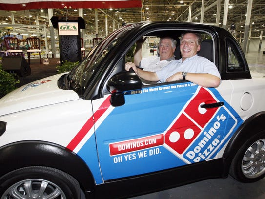 Former Mississippi Gov. Haley Barbour, left, and GreenTech Automotive chairman Terry McAuliffe take a quick spin in the plant after the unveiling of the company's new electric MyCar in Horn Lake, Miss., Friday, July 5, 2012. GreenTech has since shut down in Mississippi and filed for bankruptcy. State Auditor Stacey Pickering has demanded that the company return the $5 million borrowed from Mississippi plus $1.5 million in interest.