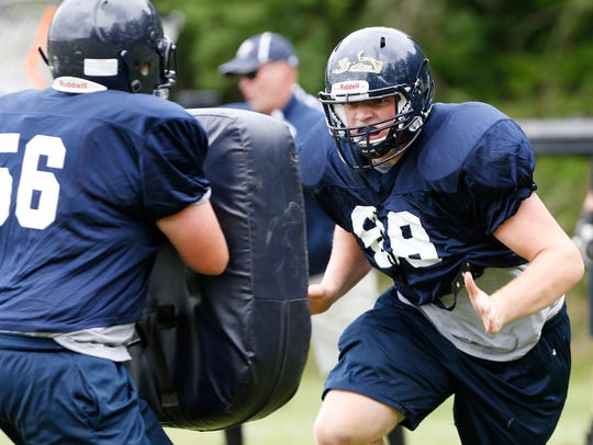 Offensive lineman Ryan Williams, right, during Harrison