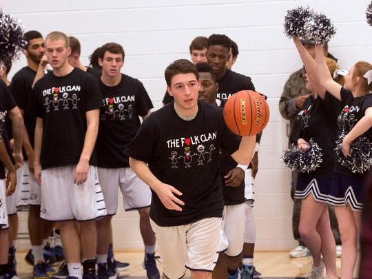 """Members of the West York High School basketball team and cheerleading squad, sport t-shirts with """"The Folk Clan"""" on it as they enter the gym for a game on Monday, Feb. 1, 2016. The student body were showing their respect for Ty Folk, the father of senior Tyler Folk, who passed away eight days ago, with the school selling the t-shirts with all money going to help out the family."""