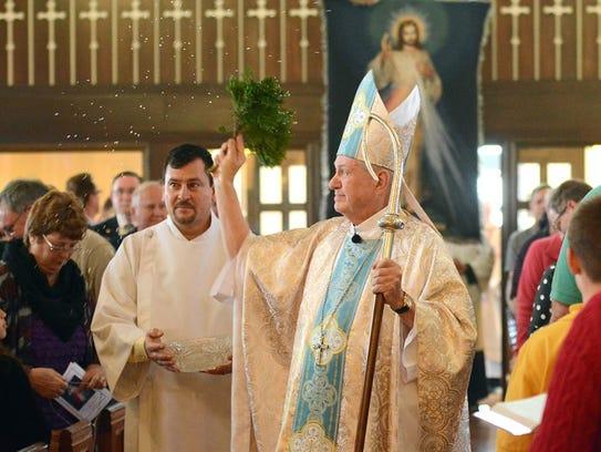 Bishop RIchard Pates celebrates mass in an undated