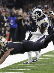 New Orleans Saints wide receiver Tommylee Lewis (11) works for a catch against Los Angeles Rams defensive back Nickell Robey-Coleman (23) during the second half of the NFC championship game Sunday. The Rams won 26-23.