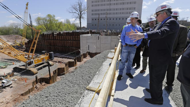 Appleton Mayor Tim Hanna, right, gives Gov. Scott Walker a tour Friday of the construction site at the new Fox Cities Exhibition Center, which is expected to be completed late this year.