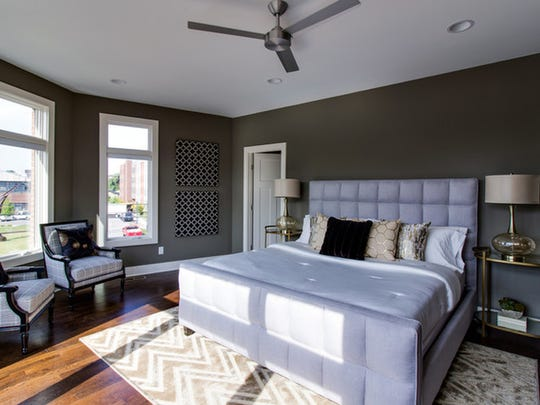 Fabulous master suite offers two walk-in closets, ensuite master bath, and a corner view.