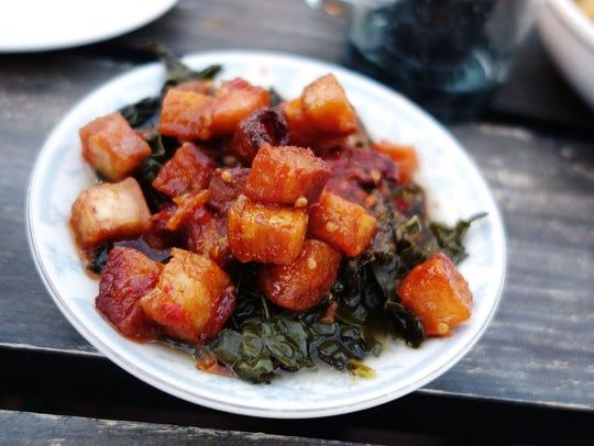 Braised greens & Calabrian pork bites at Okra. | Details: