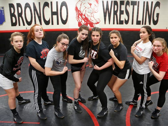 Members of the Lafayette Jeff girls wrestling team gather Wednesday, January 11, 2017, in the wrestling room at Lafayette Jeff. Pictured are Stella Cooley, from left, freshman, 132 lb. class, Ana Medrano-Alvarez, sophomore, 170 lb. class, Olivia Crose, senior, 152 lb. class, JoEllen Doyle, junior, 126 lb. class, Bethany Blackwell, senior, 182 lb. class, Alayna Proctor-Espinoza, senior, 145 lb. class, Jenifer Anderson, senior, 120 lb. class, and Ruth Satchell, senior, 106 lb. class.