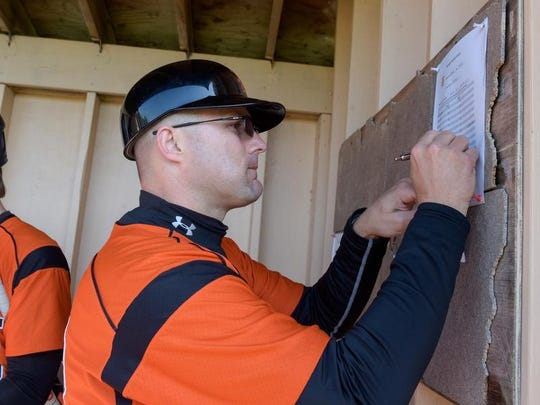 Barnegat coach Dan McCoy adjust the lineup card int he dugout during the Bengals 6-0 win over Central, with Jason Groome throwing a no-hitter.