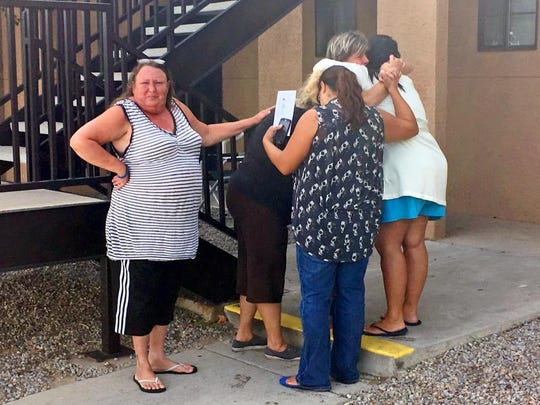 Women mourn near the apartment in Albuquerque, N.M., Thursday, Aug. 25, 2016, where the body of 10-year-old Victoria Martens was found. Police said she was sexually assaulted, strangled then dismembered.