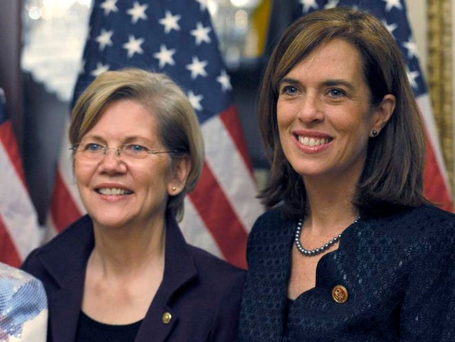 Rep.-elect Katherine Clark, D-Mass. (right) stands with Sen. Elizabeth Warren, D-Mass., after Clark posed for a photo during her ceremonial swearing-in ceremony on Capitol Hill in Washington, Dec. 12.