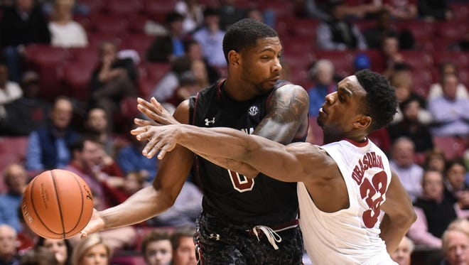 In this Feb. 15, 2015 photo, South Carolina Gamecocks guard Sindarius Thornwell (0) is defended by Alabama Crimson Tide guard Retin Obasohan (32) during the second half at Coleman Coliseum.