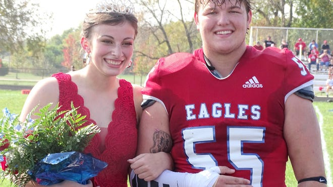 Wellsville High School seniors Jaiden Doles and Colby Stephens are crowed homecoming queen and king Saturday before the Wellsville-Osage City football game.