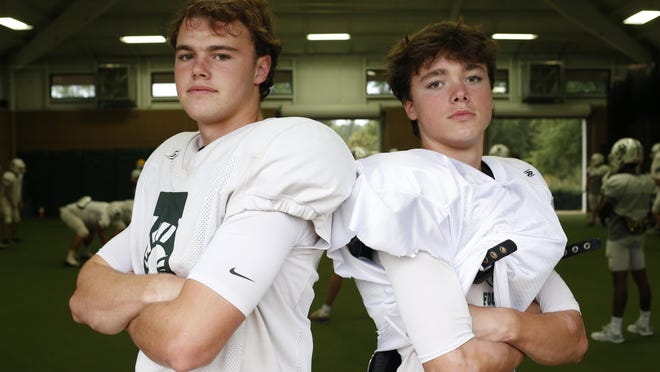 Athens Academy's Palmer and Sam Bush pose for a photo during football practice in Athens, Ga., on Tuesday, Sept. 29, 2020.