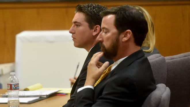 Kevin Hogrefe, of Camarillo, and his defense team listen as Senior Deputy District Attorney Rebecca Day presents her closing arguments Wednesday.