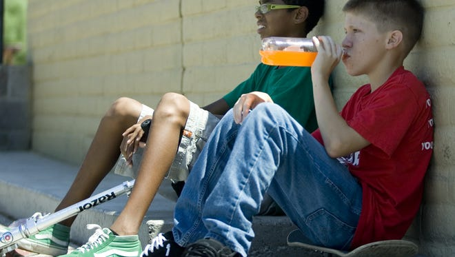 Wes Davis, 13, and Patrick Hollins, 14, take a break from the skate park at Vista del Camino Park in Scottsdale.
