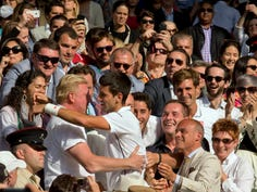 In 2014, Novak Djokovic (SRB) climbed into his box with his coaching team and Boris Becker to celebrate after recording match point  against Roger Federer at Wimbledon.