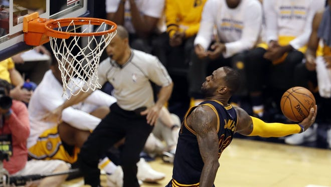 Cleveland Cavaliers forward LeBron James (23) dunks against the Indiana Pacers in game three of the first round of the 2017 NBA Playoffs at Bankers Life Fieldhouse.