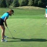 Howell's Alyssa Snider sinks a putt in the Huntmore Junior Open as part of the Kensington Junior Golf Tour.