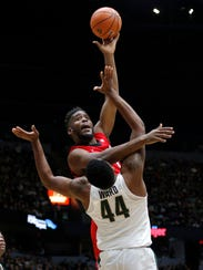 Georgia's Yante Maten (Bloomfield Hills) draws a foul against Michigan State's Nick Ward in the first half of Sunday's exhibition in Grand Rapids.