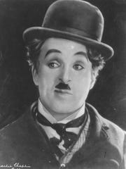Charlie Chaplin poses in a moment from the 1931 movie