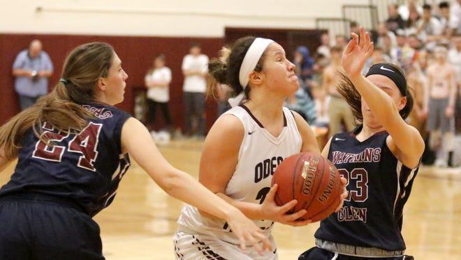 Odessa-Montour's Nakiaha Robinson splits between Watkins Glen's Taylor Kelly (24) and Danielle Leszyk on Jan. 10 at O-M.