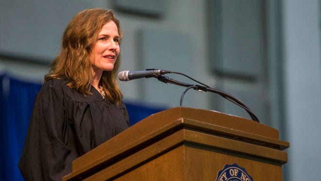 In this May 19, 2018, photo, Amy Coney Barrett, United States Court of Appeals for the Seventh Circuit judge, speaks during the University of Notre Dame's Law School commencement ceremony at the University of Notre Dame in South Bend, Ind. Barrett is on President Donald Trump's list of potential Supreme Court Justice candidates to fill the spot vacated by retiring Justice Anthony Kennedy.