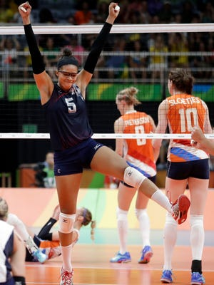 Rachael Adams, a graduate of Nativity School in Pleasant Ridge, celebrates with her U.S. volleyball team after scoring against the Netherlands at the 2016 Summer Olympics in Rio de Janeiro on Saturday. The team won the match to take home bronze.