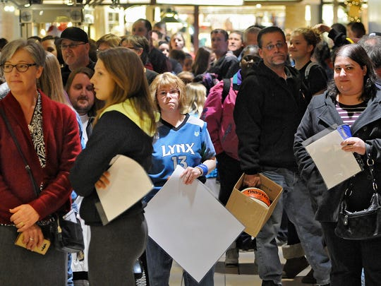 People wait in line for an appearance by Lindsay Whalen at Fan HQ in Crossroads Center Wednesday.