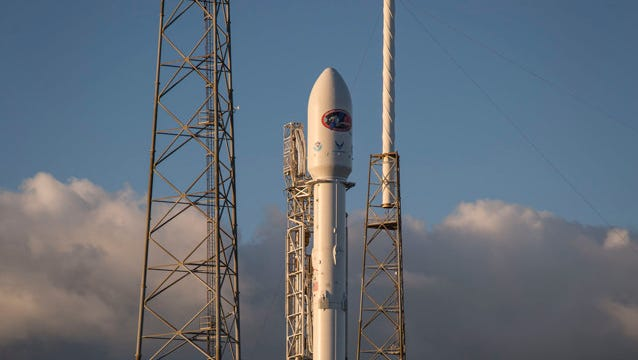 A SpaceX Falcon 9 rocket stands at Launch Complex 40 on Cape Canaveral Air Force Station in preparation for launch of the DSCOVR space weather mission.