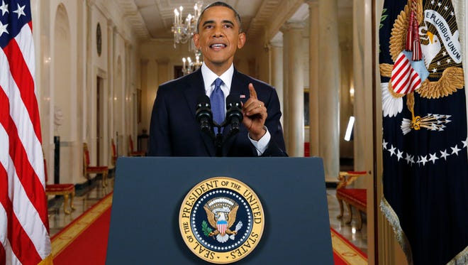 """President Barack Obama speaks during a nationally televised address from the White House in Washington, Thursday, Nov. 20, 2014. Spurning furious Republicans, President Barack Obama unveiled expansive executive actions on immigration Thursday night to spare nearly 5 million people in the U.S. illegally from deportation and refocus enforcement efforts on """"felons, not families."""""""