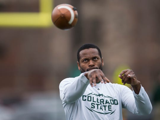 Alvis Whitted, CSU's receivers coach for the past six seasons, throws a football during drills at an April 4 practice.