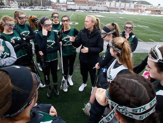 Kinnelon head coach Kailee Beal talks to her team before