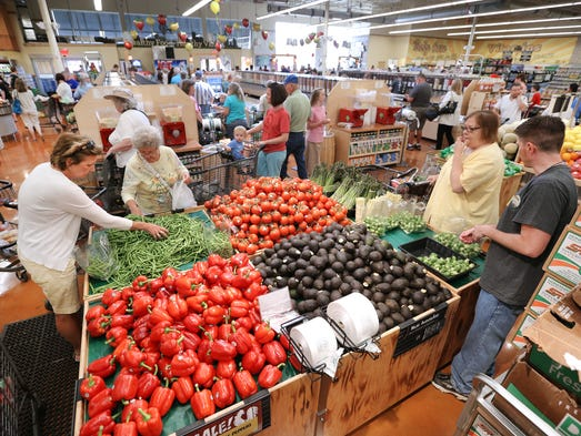 The opening of the new Fresh Thyme Farmers Market in Greenwood brought a massive amount of residents to check out the new store on Thursday, June 12, 2014 that offers many alternatives from other markets. This is the second store opened by the company and the first ever in Indiana bringing more than 100 jobs to the community. More stores are set to open in Indianapolis in the Fall of 2014.