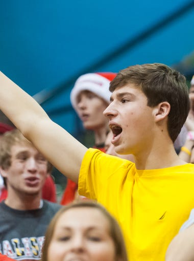 The James M Bennett 'Bleacher Creatures' cheer the Clippers on against Westminister in the Governor's Challenge on Monday afternoon at the Wicomico County Youth and Civic Center.