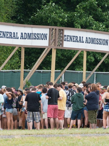 Campers line up at the entrance for the Firefly Music Festival in Dover.