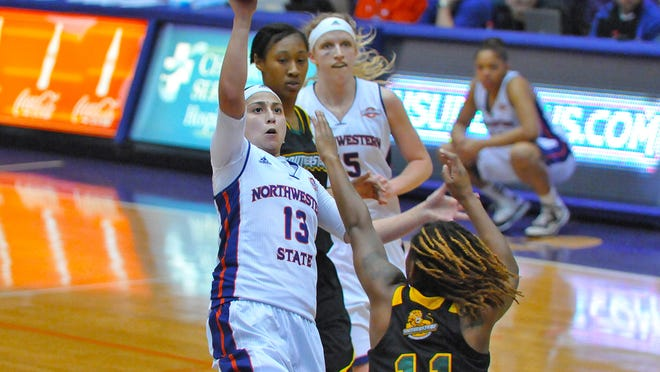 NSU's Janelle Perez (13) drove the Lady Demons' offense in their 71-60 victory against Southeastern Louisiana at Prather Coliseum on Thursday. She scored a game-high 22 points and grabbed a career-high 12 rebounds for her first career double-double.