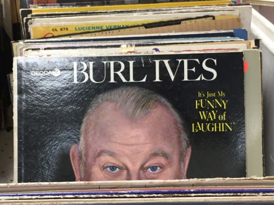 Singer Burl Ives peeks at Goodwill shoppers from the cover of a 1962 album.