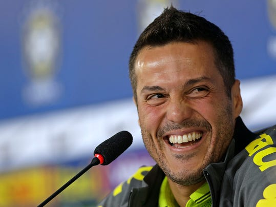 Brazil's goalkeeper Julio Cesar smiles during a press conference after a training session of the Brazilian national soccer team in Teresopolis, Brazil, Thursday, June 19, 2014. Brazil plays in group A of the 2014 soccer World Cup. (AP Photo/Andre Penner)
