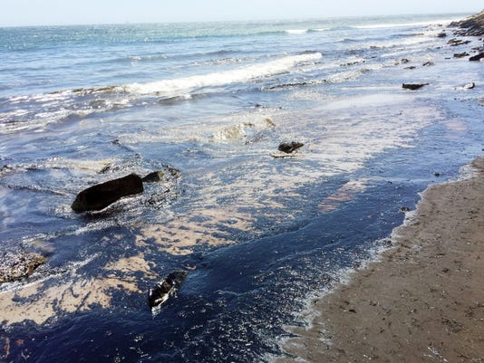 This photo provided by the Santa Barbara County Fire Department shows an oil slick from a broken pipeline off the central California coast near Santa Barbara on Tuesday, May 19, 2015.