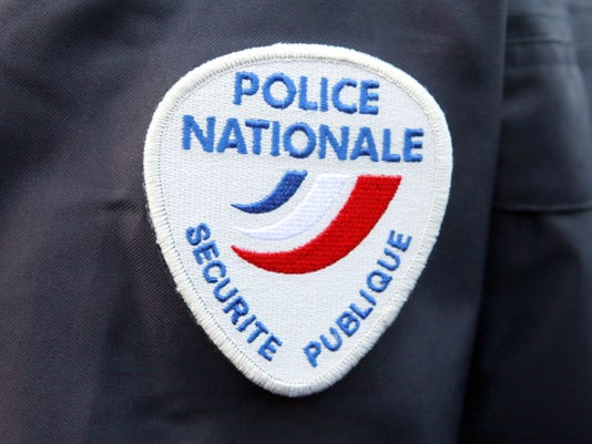 FILE - This March 18, 2015 file photo shows the logo of the French national police during a ceremony in homage to the police officers killed during the Jan. 7, terrorist attacks in Paris, at the Police School of Cannes-Ecluses, south of Paris.